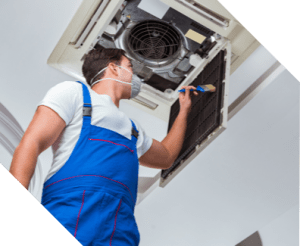 man applying protection to air conditioner