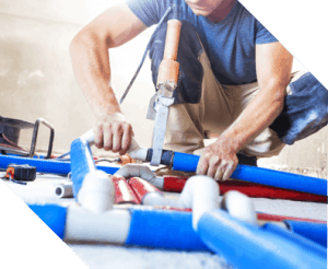 plumbing expert fixing pipes in commercial building