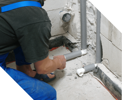 plumbing expert fixing commercial pipes