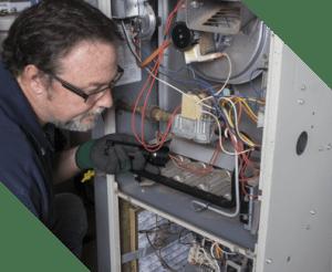 man doing an emergency repair on a home furnace