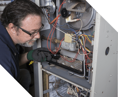 man doing an emergency repair on a home furnace
