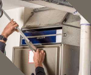 man providing regular furnace maintenance