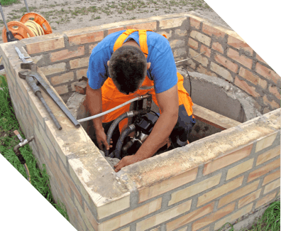 man repairing a sump pump