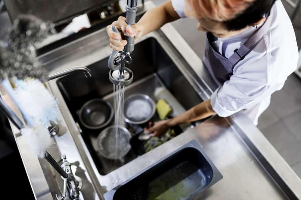 restaurant kitchen washing in sink